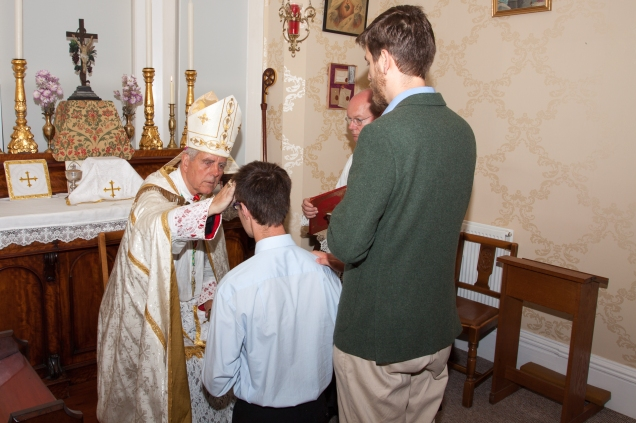 The Confirmation ceremony of one of the pilgrims before Mass on 31st August.