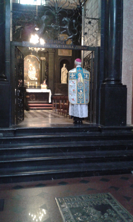 The Bishop standing in the chapel of the Shrine of Jasna Gora and before offering the Mass.